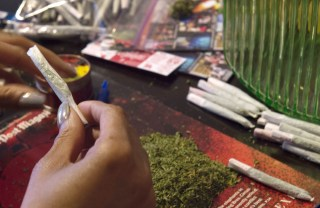 Image: A member of the D.C. Marijuana Coalition prepares joints
