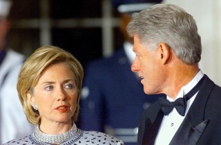 Image: President Bill Clinton and First Lady Hillary Rodham Clinton talk prior to an official State Dinner at the White House in Washington, DC, Sept. 16, 2017.