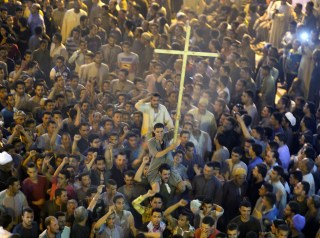 Image: Coptic Christians shout after the funeral of some of the bus attack victims.