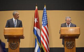 Image: President Barack Obama listens as Cuban President Raul Castro speaks