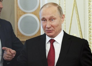 Image: Russian President Putin attends a meeting with representatives of international news agencies in St. Petersburg