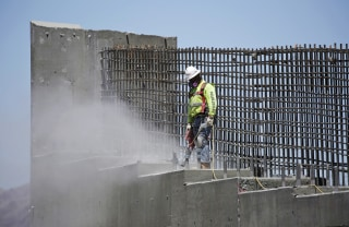 Image: a man works on the Southern Nevada portion of U.S. Interstate 11