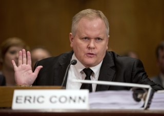 Image: Attorney Eric Conn gestures as he invokes his Fifth Amendment rights against self-incrimination during a Senate Homeland Security and Governmental Affairs committee hearing on Capitol Hill in Washington, Oct. 7, 2013.