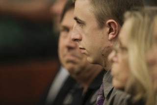 Image: Micah Fletcher sits in court as Jeremy Christian shouts during a court appearance