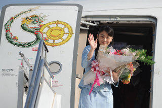 Image: Japan's Princess Mako waves prior to her departure