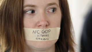Image: Rachel Jordan protests outside the House gallery during a special session of the North Carolina General Assembly at the Legislative Building in Raleigh, Dec. 16, 2016.