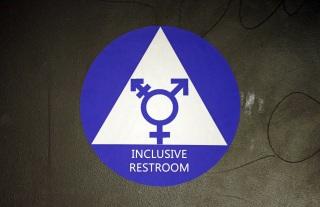 Image: A new sticker designates a gender neutral bathroom at a high school in Seattle.