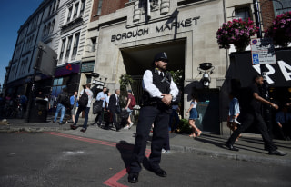 Image: A police officer stands in front of an entrance to Borough Market