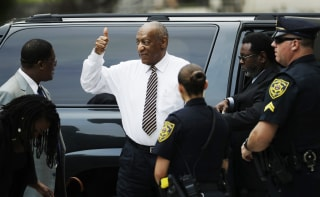 Image: Bill Cosby gives a thumbs up as he arrives at his sexual assault trial