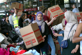 Image: Clothing and other supplies are stored near a tower block which was destroyed in a fire disaster in West London