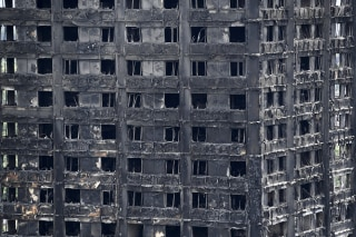 Image: The burned shell of Grenfell Tower in London where at least 30 died and dozens are still missing.