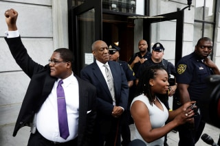 Image: Actor and comedian Bill Cosby stands as his publicist Andrew Wyatt raises his fist after a judge declared a mistrial in Cosby's sexual assault trial at the Montgomery County Courthouse in Norristown, Pennsylvania, June 17, 2017.