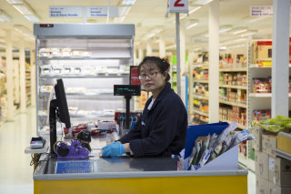 Image: A cashier at the Korea Foods superstore in New Malden