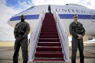 Image: Secretary of Defense Leon E. Panetta, at top of stairs, waves as he boards a U.S. Air Force E-4B National Airborne Operations Center aircraft