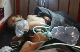 Image: Syrian children receive treatment at a small hospital in the town of Maaret al-Noman