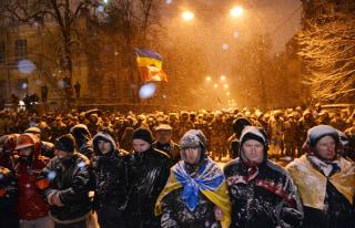 Image: Pro-EU protesters face riot police in Kiev on December 9, 2013.