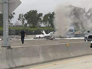 Image: aftermath of the Small plane crash on I-405 near Santa Ana, California