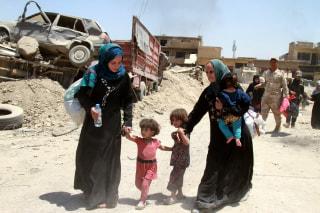 Image: Civilians flee Mosul
