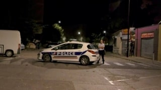 Image: Police guard a street near the scene of the shooting in front of a mosque in Avignon, France.