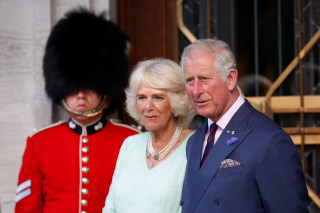 Image: Britain's Prince Charles and Camilla, Duchess of Cornwall, take part in a ceremony officially designating the Queen?EUR(TM)s Entrance at Rideau Hall in Ottawa
