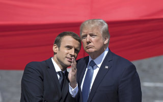 Image: Emmanuel Macron talks to Donald J. Trump during the traditional military parade at Bastille Day celebrations in Paris