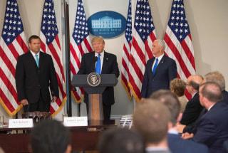 Image: President Donald Trump speaks alongside Kansas Secretary of State Kris Kobach, left, and Vice President Mike Pence