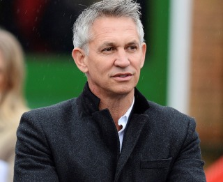 Image: Sports broadcaster Gary Lineker talks with students at St Brigid's Catholic Primary School in Birmingham