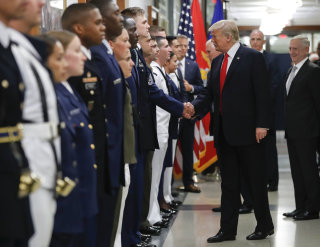 Image: President Donald Trump greets military personnel during his visit to the Pentagon