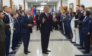 Image: President Donald Trump greets members of the U.S. military alongside Vice President Mike Pence at the Pentagon