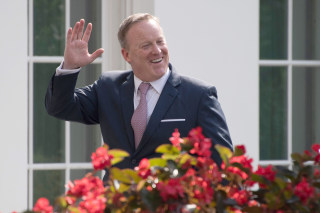 Image: Outgoing White House Press Secretary Sean Spicer smiles as he walks into the West Wing of the White House in Washington, DC, on July 21, 2017.