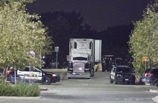 Image: Officials investigate a truck that was found to contain 38 suspected illegal immigrants in San Antonio, Texas, July 23, 2017.