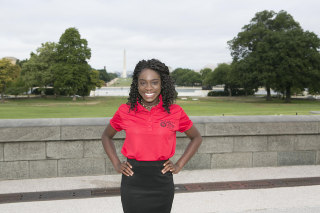 Image: Oti Ogbeide in front of the Washington Monument on Capitol Hill