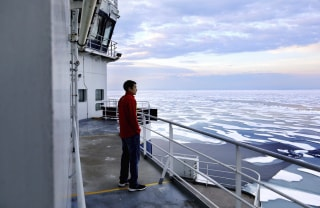 Image: David Kullualik looks over the sea ice of Peel Sound.