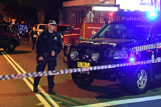 Image: Police man a check point in the Sydney inner suburb of Surry Hills