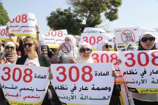 Image: Women activists protest in front Jordan's parliament in Amman