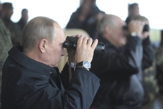 Image: Russian President Vladimir Putin watches the closing stage of Zapad 2013