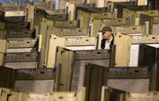 Image: A technician gets voting machines ready for the presidential election, in Philadelphia
