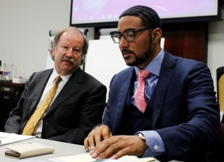 Image: Attorneys Charles Monette, left and Justin Bamberg, chat prior to a citizens review board hearing