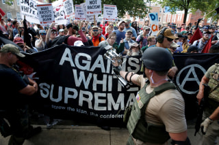 Image: Members of white nationalists are met by a group of counter-protesters in Charlottesville, Virginia, Aug. 12, 2017.