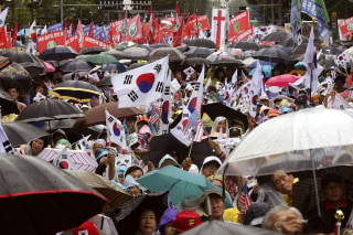 Image: South Korean protesters stage a rally against North Korea's recent missile launches