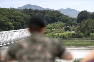 Image: A South Korean soldier looks into North Korea on Wednesday.