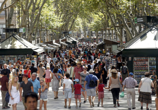 Image: FILE PHOTO: People walk by Las Ramblas in Barcelona