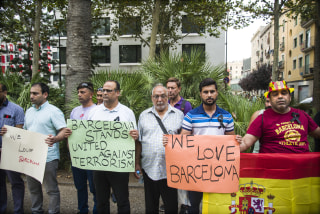 Image: Locals gather in El Raval to condemn the violence and acts of terrorism that befell Barcelona, Aug. 19, 2017.