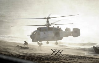 Image: Servicemen take part in the joint war games Zapad-2013