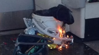 Image: A white plastic bucket on fire