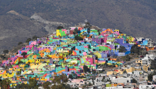 Image: Houses sit on a hill painted with vivid colors in Pachuca, Hidalgo, Mexico on April 4, 2017.