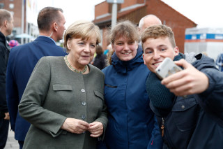 Image: Angela Merkel poses for a selfie