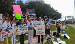 Image: Protesters demonstrate against vaccine laws in Houston