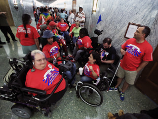 Image: Marilee Adamski-Smith from Brookfield, Wisconsin, left, and Colleen Flanagan of Boston, center, join others outside a hearing room where the Senate Finance Committee will hold a hearing to consider the Graham-Cassidy healthcare proposal