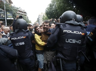 Image: Catalans and police clash outside the Ramon Llull school.
